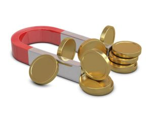 Magnet and golden coins isolated