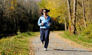 Tracy Higginbotham runs at Erie Canal Park in Camillus Tuesday. Higginbotham faced astounding hair loss that at first seemed like it might require brain surgery, but it turned out to be an autoimmune disease. she runs to stay fit and balances that with yoga. Michelle Gabel/The Post-Standard